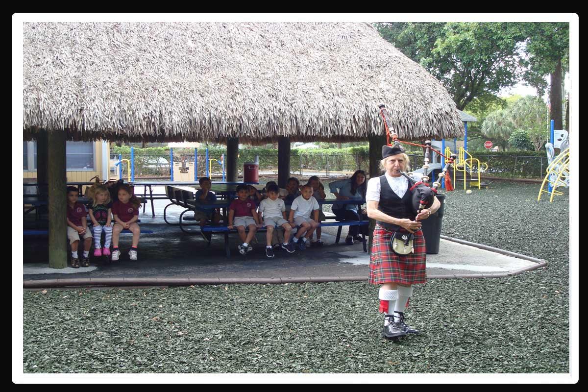 Montessori students enjoy bagpipe tunes